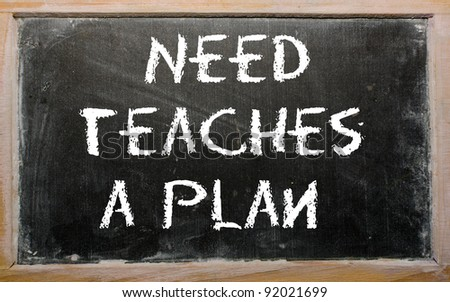 "Blackboard writings ""Need teaches a plan"" - stock photo"