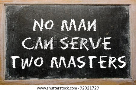 "Blackboard writings ""No man can serve two masters"" - stock photo"