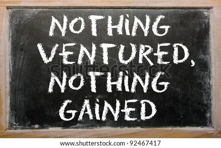 "Blackboard writings ""Nothing ventured, nothing gained"" - stock photo"