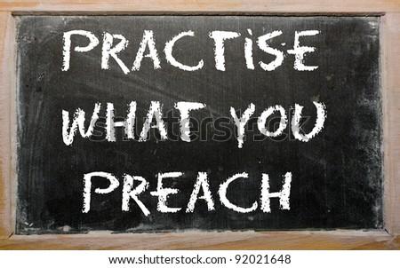 "Blackboard writings ""Practise what you preach"" - stock photo"