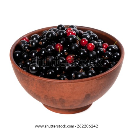 Blackcurrants with redcurrants in ceramic bowl. Isolated on white background. - stock photo
