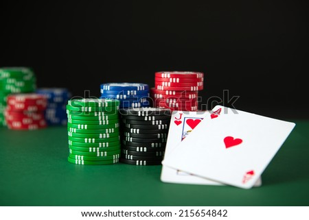 Blackjack and poker chips on the table - stock photo