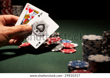 Blackjack hand of cards and casino chips - stock photo
