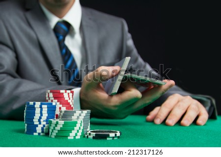 Blackjack Or Poker Game, Casino Worker Shuffling Cards On The Background  - stock photo