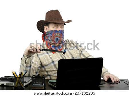 Blackmailer in cowboy clothes threatening with stolen flash drive during on-line conversation in robbed office - stock photo