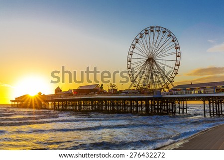 Blackpool Central Pier at Sunset with Ferris Wheel, Lancashire, England UK - stock photo