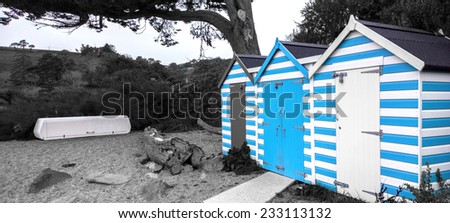 Blackpool sands, Dartmouth, Devon, United Kingdom - October 12, 2014: 3 beach shacks at Blackpool Sands, Dartmouth, Devon, United Kingdom, showing a life guard storage unit next to 3 beach shacks - stock photo