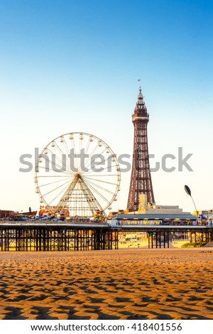 Blackpool Tower and Central Pier Ferris Wheel, Lancashire, England, UK - stock photo