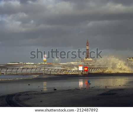 Blackpool tower and promenade in a storm - stock photo