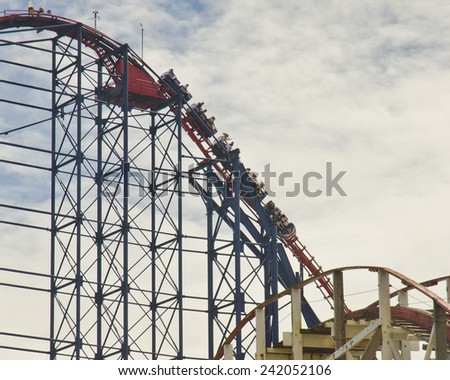 BLACKPOOL, UNITED KINGDOM - JUNE 24: the Big One rollercoaster at Blackpool Pleasure Beach on June 24, 2014 in Blackpool, United Kingdom. The Big One was built in 1994 at a cost of GBP 12 million. - stock photo