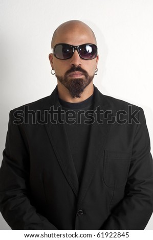 blacks man with glasses, beard and black jacket, bouncer bodyguard - stock photo