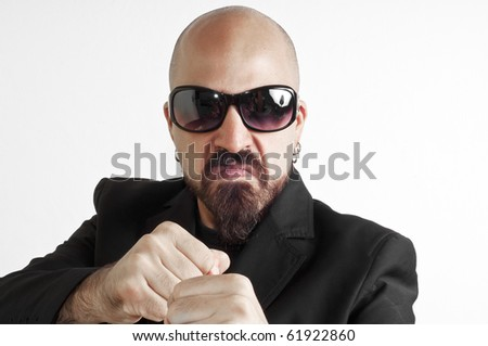 blacks man with glasses, beard and black jacket, bouncer bodyguard