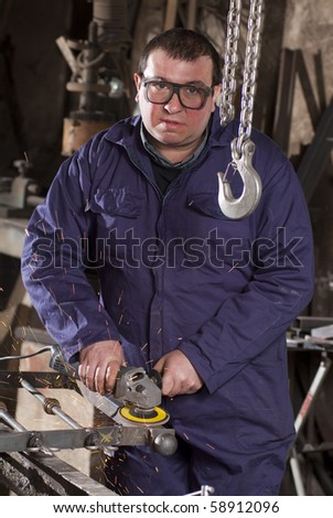 Blacksmith in his workshop - stock photo