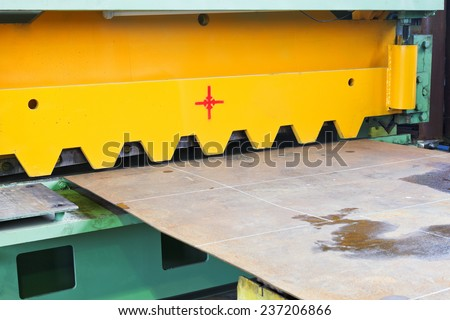 blade of cutting machine for metal sheets in mechanical workshop - stock photo