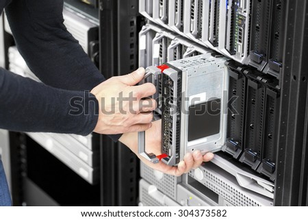 Blade server installation in large datacenter - stock photo