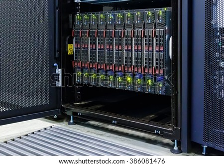 blade server with the matrix code and blur blue toning - stock photo