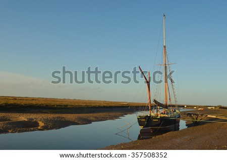 BLAKNEY, NORFOLK, ENGLAND - DECEMBER 29, 2015: The sailing barge Juno moored at Blakney North Norfolk England.