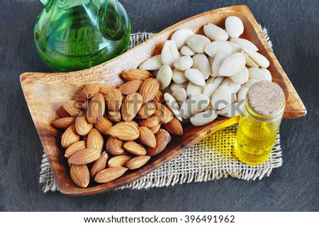 Blanched Almond, Peeled almonds and almond oil.  - stock photo