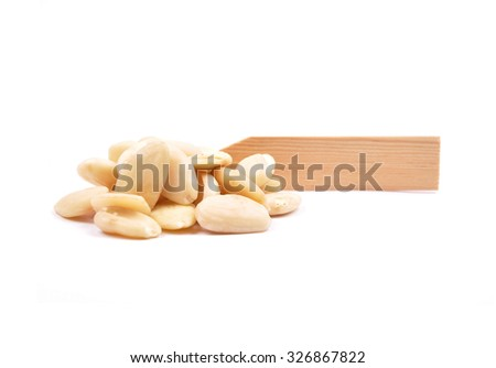 Blanched almonds at plate - stock photo