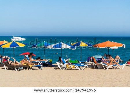 BLANES, SPAIN - 28 JULY: Tourists enjoy at the beach in the summer in the Blanes beach, small village in Costa Brava. Blanes July 28, 2013.