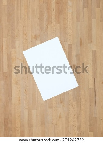 Blank A4 office paper on a wooden floor - stock photo