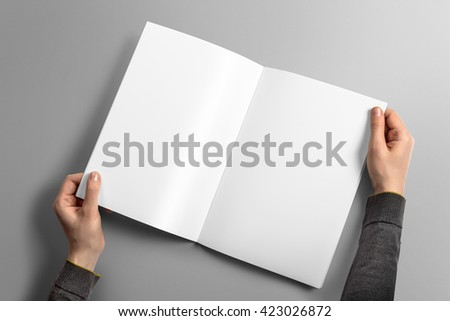 Blank A4 photorealistic brochure mockup on light grey background, 3D illustration. - stock photo