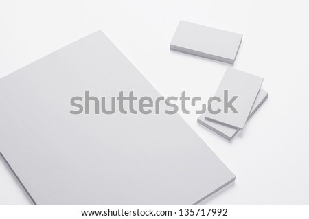 Blank A4 print paper and Business cards isolated on white background with soft shadows / Stationary - stock photo