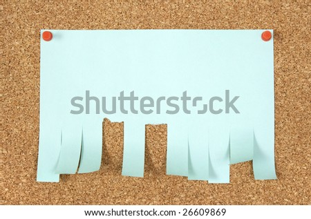Blank ad with cut slips pinned to corkboard. - stock photo