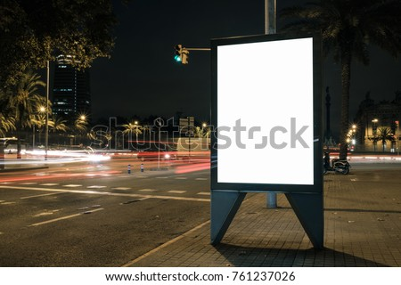 Blank advertisement lightbox in the street at night. Commercial display mock-up.