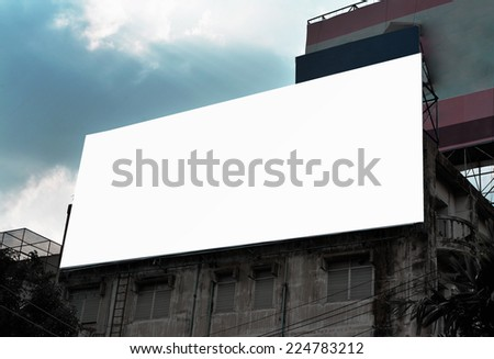 blank advertising billboard at old grunge building - stock photo