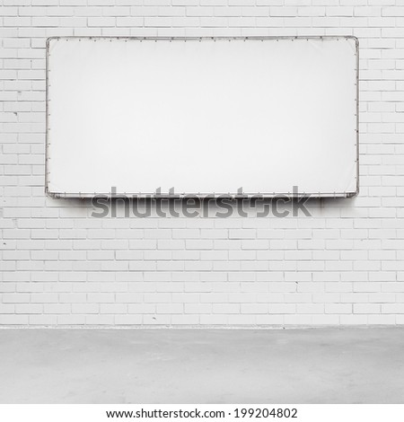Blank advertising billboard on a brick wall. - stock photo