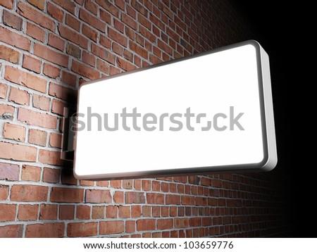 Blank advertising billboard on brick wall at night - stock photo