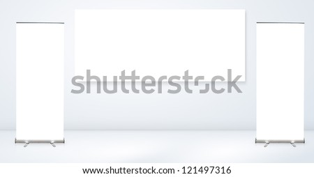 Blank advertising billboard With roll up banner in empty room - stock photo