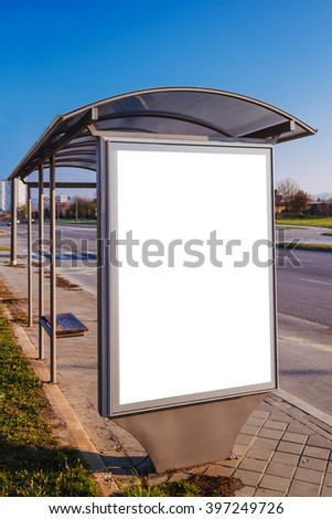 Blank advertising poster board at city bus stop on a sunny day - stock photo