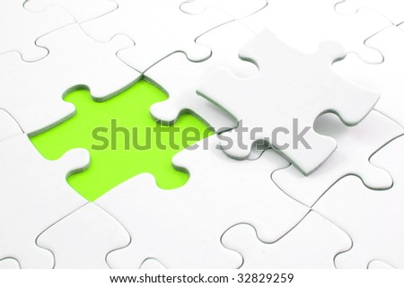 blank and white puzzle with missing piece - stock photo