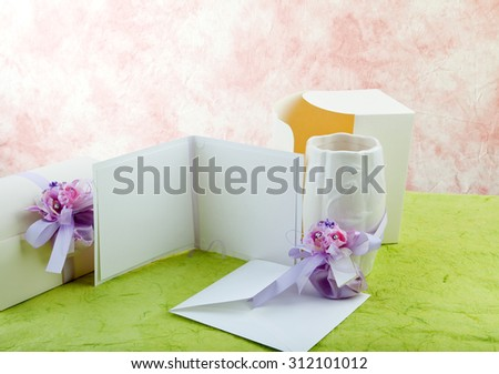 Blank announcement wedding, violet wedding decor and boxes. - stock photo