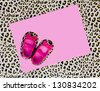 blank baby shower invite with pink shoes and leopard background - stock photo