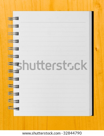 blank background. paper spiral notebook over table