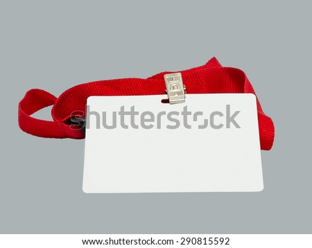 Blank badge on red strap against grey background. Conference concept. - stock photo