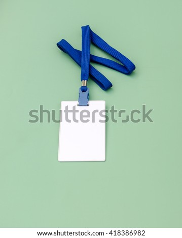Blank badge template in plastic holder with blue strap