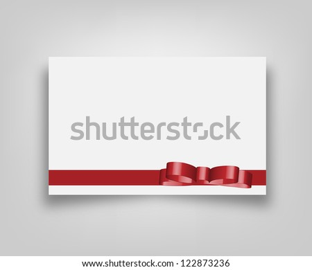 Blank banner card with red ribbon and bow decoration - stock photo