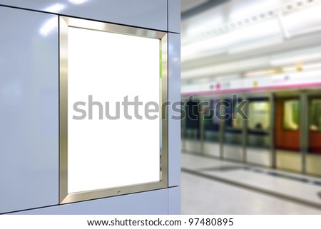 Blank big vertical / portrait orientation billboard on modern blue wall with platform and train background - stock photo