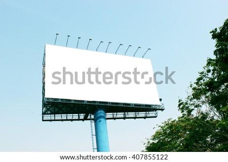 Blank billboard against blue sky - stock photo