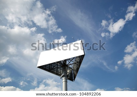 Blank billboard against blue sky and clouds - stock photo