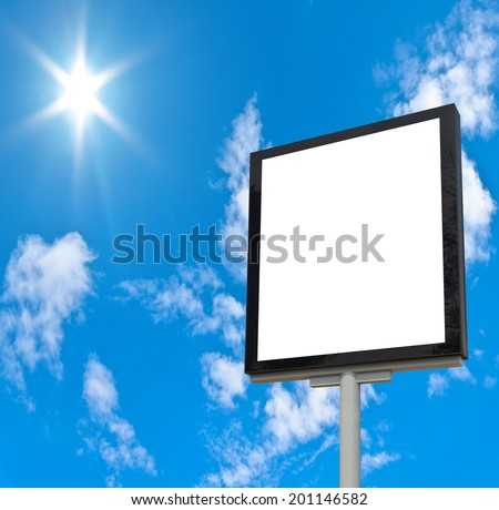 Blank billboard against blue sky, put your own text here - stock photo