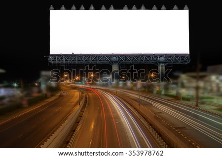 blank billboard and light on highway road in night time