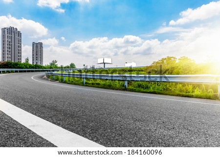 blank billboard aside the freeway at day. - stock photo
