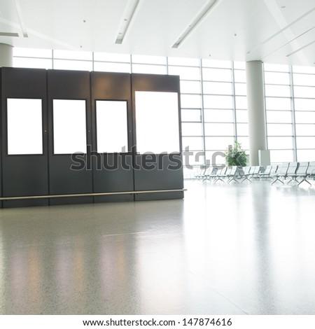 Blank billboard at a international airport. - stock photo