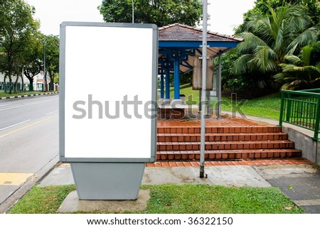Blank billboard display at bus stop with clipping path for your advertising - stock photo