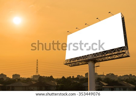 Blank billboard for advertisement with sunset in city.